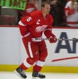 Nicklas Lidstrom skates along the boards during pre-game warmups.