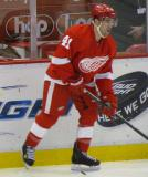 Chris Conner skates along the boards during pre-game warmups.