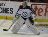 Winnipeg's Ondrej Pavelec gets set in his net during pre-game warmups.
