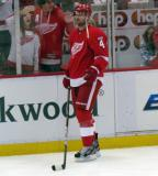 Jakub Kindl stands along the boards during pre-game warmups.