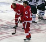 Nicklas Lidstrom and Pavel Datsyuk stand at center ice during pre-game warmups.
