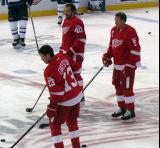 Pavel Datsyuk, Henrik Zetterberg and Nicklas Lidstrom stand at center ice during pre-game warmups.