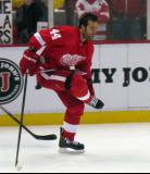 Todd Bertuzzi fixes his skate while gliding on one leg during pre-game warmups.