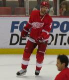 Jakub Kindl skates near the boards during pre-game warmups.