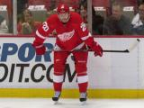 Drew Miller crouches along the boards during pre-game warmups.