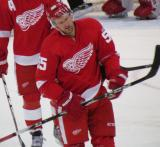 Niklas Kronwall comes back to the Detroit bench after taking a puck to the face.