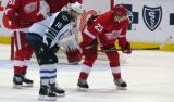 Brad Stuart lines up for a faceoff across from Winnipeg's Andrew Ladd.