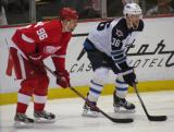Tomas Holmstrom lines up for a faceoff opposite Winnipeg's Mark Flood.