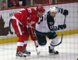 Johan Franzen lines up for a faceoff opposite Winnipeg's Kyle Wellwood.