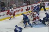 Todd Bertuzzi is the only person on the ice who finds a loose puck in the crease, knocking it into the open side of Vancouver goalie Roberto Luongo's net.