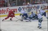 Derek Meech beats Vancouver goalie Curtis Sanford on a wraparound chance.