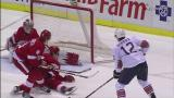Jimmy Howard lunges to make a pad stop on Edmonton's Alexandre Giroux.