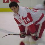 Brendan Shanahan crouches over near the blue line during pregame warmups.