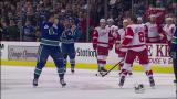 Justin Abdelkader squares off at center ice with Vancouver's Maxime Lapierre.