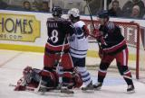 Jon Insana and Danny Syvret of the Grand Rapids Griffins tie up Tyson Nash of the Toronto Marlies as goaltender Jimmy Howard freezes the puck.
