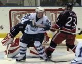 Kris Newbury of Toronto and Matt Ellis of Grand Rapids battle in front of the Griffins' net.