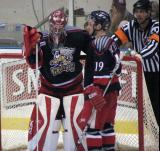 Jimmy Howard and Eric Himelfarb of the Grand Rapids Griffins stand in the crease during a stoppage in play.
