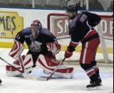 Defenseman Dan Smith keeps an eye on the area in front of Grand Rapids goaltender Jimmy Howard.