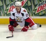 Riley Sheahan stretches on the ice during pre-game warmups before a Grand Rapids Griffins game.