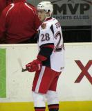 Tomas Jurco looks over his shoulder from along the boards during pre-game warmups before a Grand Rapids Griffins game.