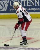 Brian Lashoff looks for a loose puck at the right faceoff circle during pre-game warmups before a Grand Rapids Griffins game.