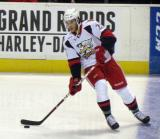 Trevor Parkes skates with the puck at the blue line during pre-game warmups before a Grand Rapids Griffins game.