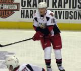 Joakim Andersson knocks the puck forward during pre-game warmups before a Grand Rapids Griffins game.
