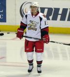 Gustav Nyquist stands in the right faceoff circle during pre-game warmups before a Grand Rapids Griffins game.