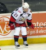 Triston Grant crouches along the boards during pre-game warmups before a Grand Rapids Griffins game.