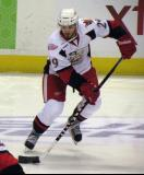 Landon Ferraro skates with the puck during pre-game warmups before a Grand Rapids Griffins game.