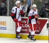 Joakim Andersson and Gustav Nyquist skate along the boards during pre-game warmups before a Grand Rapids Griffins game.