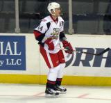 Brennan Evans skates along the boards during pre-game warmups before a Grand Rapids Griffins game.