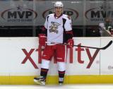 Brendan Smith stands along the boards during pre-game warmups before a Grand Rapids Griffins game.
