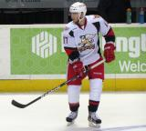 Max Nicastro skates near the boards during pre-game warmups before a Grand Rapids Griffins game.