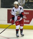 Mitch Callahan stands near the boards during pre-game warmups before a Grand Rapids Griffins game.
