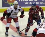 Trevor Parkes of the Grand Rapids Griffins lines up on wing opposite Louis Leblanc of the Hamilton Bulldogs for a faceoff.
