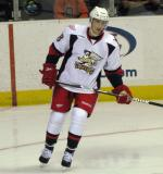 Joakim Andersson skates through the right faceoff circle during a stoppage in play in a Grand Rapids Griffins game.