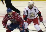 Landon Ferraro of the Grand Rapids Griffins shadows Michael Bournival of the Hamilton Bulldogs.
