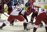 Landon Ferraro of the Grand Rapids Griffins takes a faceoff against Darryl Boyce of the Hamilton Bulldogs.  Francis Pare is on Ferraro's right wing.