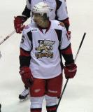Mitch Callahan looks over to the ref as he's assessed a double-minor for butt-ending in a Grand Rapids Griffins game.