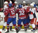 A scrum erupts along the Grand Rapids Griffins' bench, with Louis-Marc Aubry, Mitch Callahan and Brendan Smith representing the Griffins against the Hamilton Bulldogs' Zack Stortini, Fredric St. Denis and Kyle Hagel.