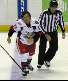 Mitch Callahan heads to the penalty box after a fight in a Grand Rapids Griffins game.