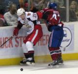 Tomas Jurco of the Grand Rapids Griffins breaks through a check by Darryl Boyce of the Hamilton Bulldogs.