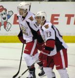 Joakim Andersson and Gustav Nyquist skate back to the bench during a stoppage in play in a Grand Rapids Griffins game.