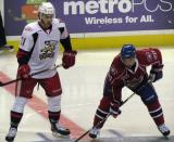 Trevor Parkes of the Grand Rapids Griffins lines up for a faceoff alongside Louis Leblanc of the Hamilton Bulldogs.