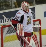 Tom McCollum leans back in his crease during a stoppage in play in a Grand Rapids Griffins game.