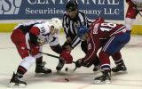Joakim Andersson of the Grand Rapids Griffins takes a faceoff against Michael Bournival of the Hamilton Bulldogs.