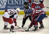 Landon Ferraro of the Grand Rapids Griffins takes a faceoff against Michael Bournival of the Hamilton Bulldogs.