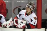 Backup goalie Jordan Pearce sits on the Grand Rapids Griffins' bench.