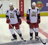 Brennan Evans and Triston Grant stand at center ice before the start of a Grand Rapids Griffins game.